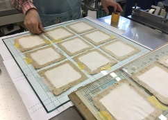 Preparing Washi on a grid for silk screen printing