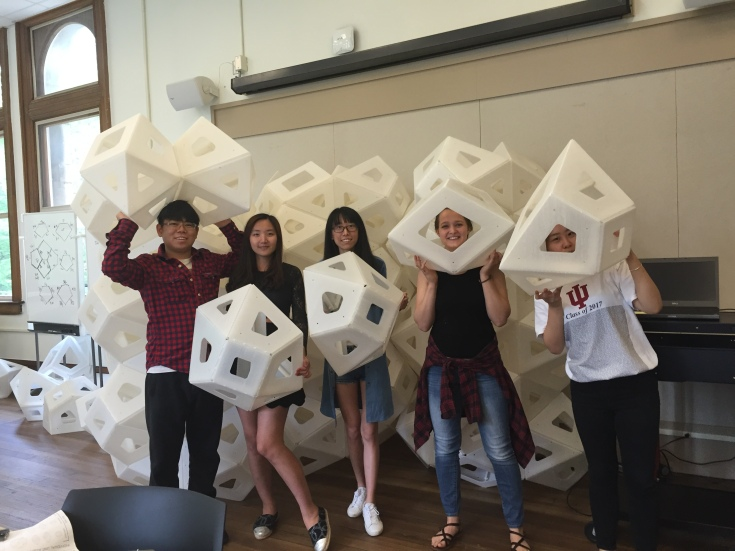 Students having fun with polyhedrons.