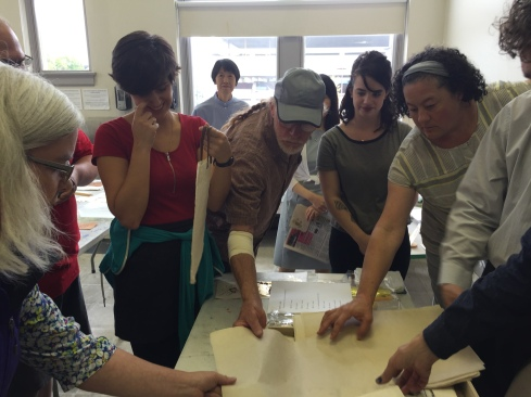 Participants feeling the paper texture.